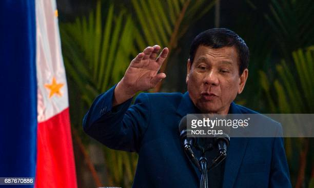 Philippine President Rodrigo Duterte speaks during a press conference at Manila international airport in Manila on May 24 after returning from a...