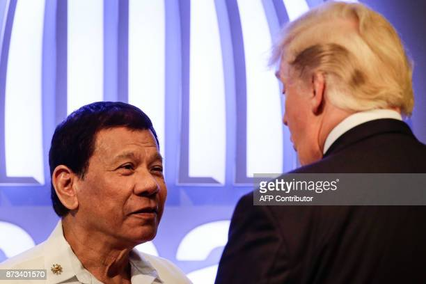 Philippine President Rodrigo Duterte talks to US President Donald J Trump before the opening ceremony of the 31st Association of South East Asian...