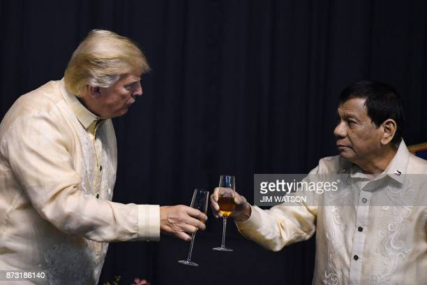 Philippine President Rodrigo Duterte toasts US President Donald Trump during a special gala celebration dinner for the Association of Southeast Asian...