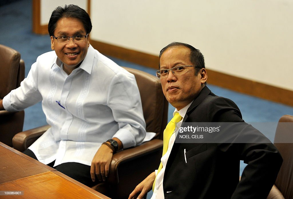 Philippine president-elect Benigno Aquino (R) and his running mate Senator Manuel Roxas (L) attend a special session at the Senate in Manila on May 24, 2010. The son of recently deceased democracy heroine Corazon Aquino won the May 10 national elections by a landslide after campaigning on pledges to wipe out corruption in the impoverished nation.