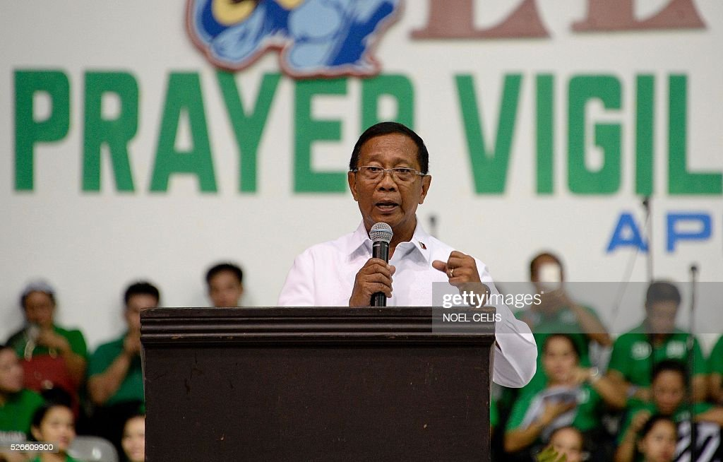 Philippine Presidential candidate and Vice President Jejomar Binay speaks during the Pro-Catholic Born again religious group El Shaddai prayer vigil overnight celebration in Manila on May 1, 2016. More than 17,000 positions ranging from president to town councillors will be contested when the Philippines holds national elections on May 9, 2016. About 80 percent of the Philippines' 100 million people are Catholic, a legacy of Spanish colonial rule that ended in the late 1800s. / AFP / NOEL