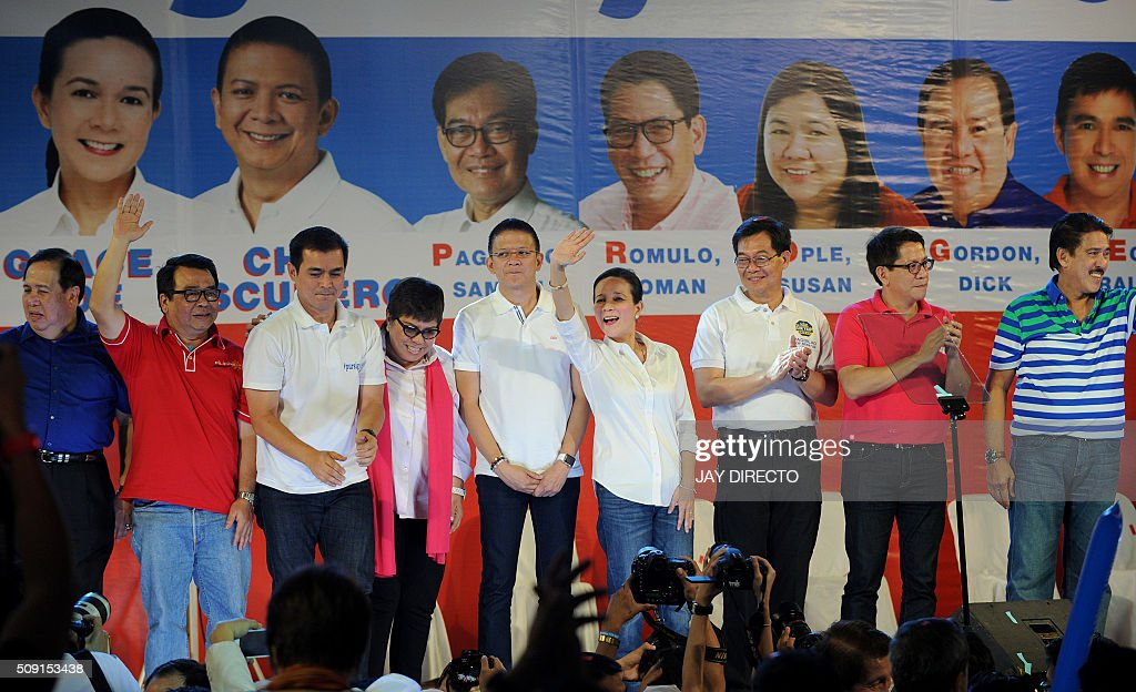 Philippine presidential candidate Grace Poe (5fth-R) waves to supporters alongside her running mate Senator Francis 'Chiz' Escudero (5fth-L) with their senatorial slate as they launch their campaigns for the May national elections in Manila on February 9, 2016. A cliffhanger race to lead the Philippines began February 9, with the adopted daughter of a dead movie star and a tough-talking politician who claims to kill criminals among the top contenders. AFP PHOTO / Jay DIRECTO / AFP / JAY DIRECTO