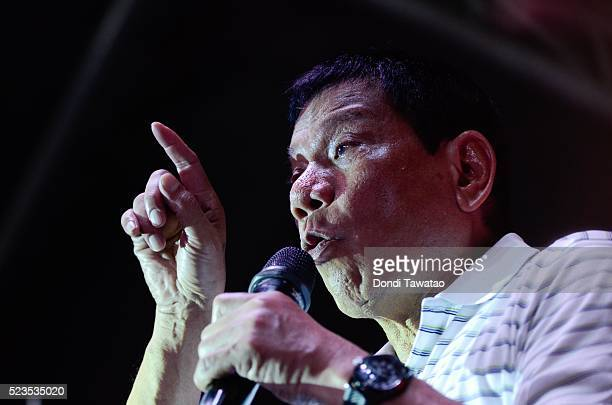 Philippine presidential candidate Rodrigo Duterte gestures during a campaign rally on April 23 2016 in Manila Philippines The toughtalking mayor of...