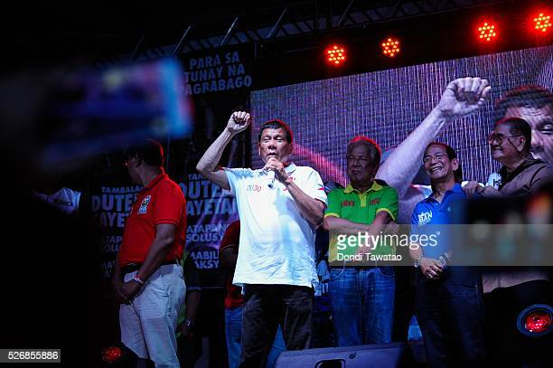 Philippine presidential candidate Rodrigo Duterte gestures during a labor day campaign rally on May 1 2016 in Manila Philippines Duterte a...