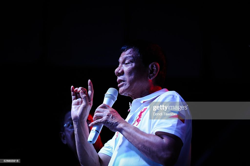 Philippine presidential candidate Rodrigo Duterte gestures during a labor day campaign rally on May 1, 2016 in Manila, Philippines. Duterte, a tough-talking mayor of Davao in Mindanao has been the surprise pre-election poll favourite pulling away from his rivals despite controversial speeches and little national government experience. Opinion polls has shown Mr Duterte has maintained his lead with 33 percent support in the Philippines as Senator Grace Poe looks at impossible odds, with only 22 percent supporting her. The Philippine presidential campaign ends on May 7 with elections slated for May 9 and features 5 presidential candidates vying for the top post.