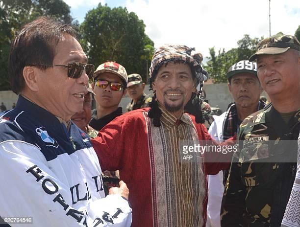 Philippine presidential peace adviser secretary Jesus Dureza with Muslim rebel leader Nur Misuari of the Moro National Liberation Front and military...