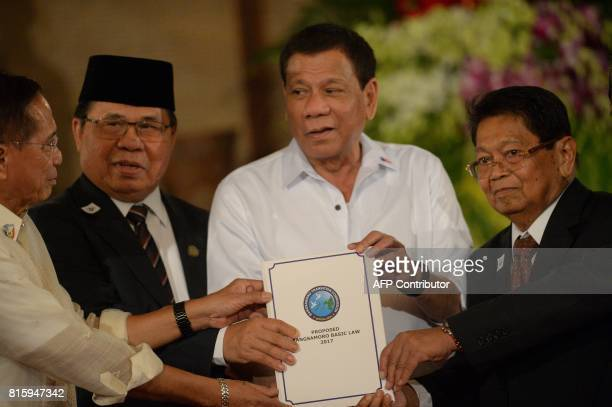 Philippine Secretary of the Peace Process Jesus Dureza AlHajj Murad chairman of the Moro Islamic Liberation Front Philippine President Rodrigo...