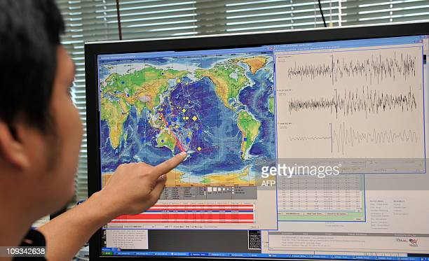Philippine seismologist Winchelle Sevilla points to a map and seismograph of an earthquake which struck New Zealand earlier in the day during a press...