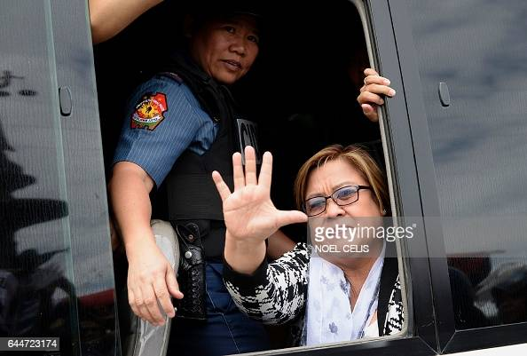 Philippine Senator Leila De Lima a former human rights commissioner who is one of Duterte's most vocal opponents waves to her supporters after...