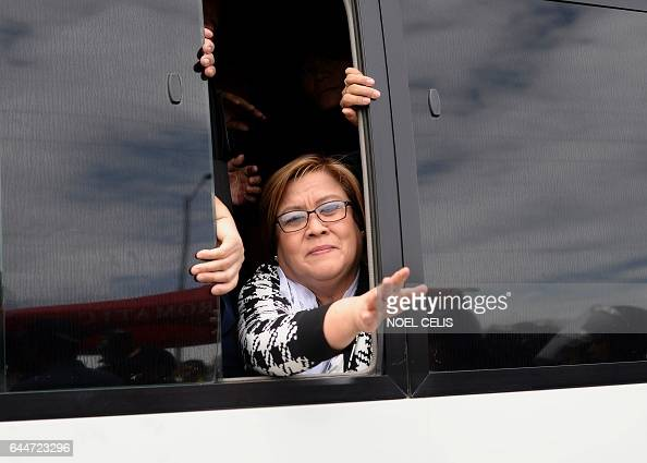 TOPSHOT Philippine Senator Leila De Lima a former human rights commissioner who is one of Duterte's most vocal opponents waves to her supporters...