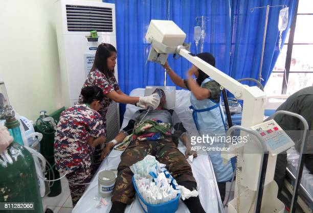 A Philippine soldier is treated after being injured in an encounter with suspected Abu Sayaff militants at Camp Bautista Hospital in Jolo Sulu on the...