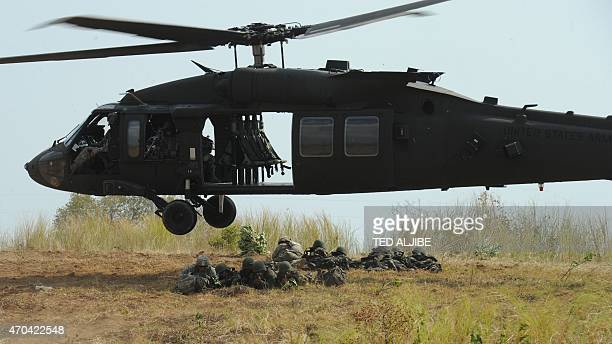 Philippine soldiers and US army soldiers from 2nd Stryker Brigade Combat of the 5th Infantry Division based in Hawaii take their positions after...