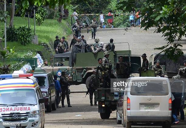 Philippine soldiers are pictured after engaging members of the ISaffiliated Maute group outside their military camp in Marawi on the southern island...