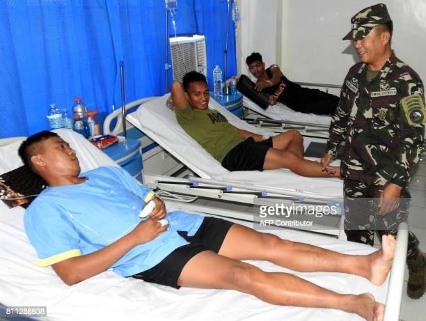Philippine soldiers are treated after being injured in an encounter with suspected Abu Sayaff militants at Camp Bautista Hospital in Jolo Sulu on the...