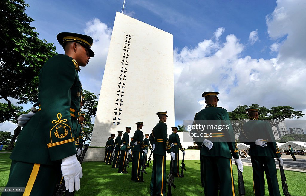 Philippine soldiers form up a commemoration service marking US Memorial Day honouring the fallen soldiers during World War II at the Manila American Cemetery in Fort Bonifacio, Manila on May 30, 2010. At least 17,000 graves lay in the memorial park that pays tribute to US and Philippines soldiers that fought side by side during World War II.