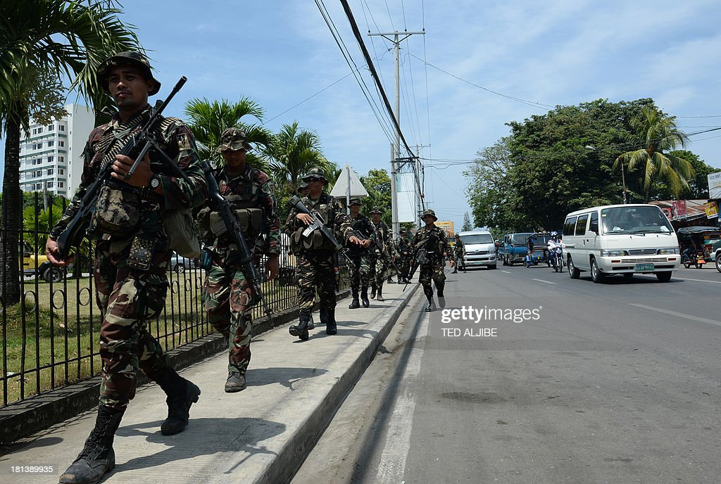 Philippine soldiers patrol the streets as government forces clash anew with remnants of Muslim rebels in Zamboanga City, on southern island of Mindanao on September 21, 2013. Philippine security forces killed eight Muslim rebels September 19, as they hunted the remnants of a guerrilla force hiding in homes of a major city and believed to be holding hostages.