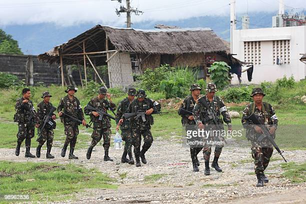 Philippine soldiers secure the area of the provincial capitol as vote counting continues to try to determine the next President of the Philippines on...