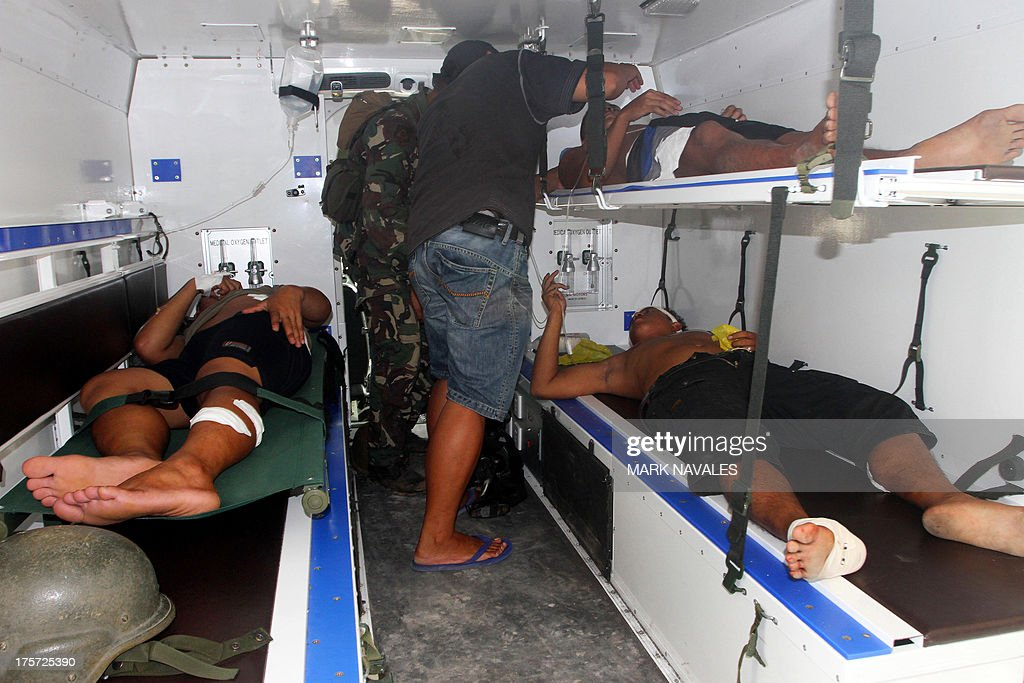 Philippine soldiers wounded by a roadside bomb, lie on stretcher inside a military emergency vehicle to be transported to a hospital in Sharif Aguak town, Maguindanao province, on the southern island of Mindanao on August 7, 2013. Two roadside bombs exploded in the southern Philippines on August 7, one of which wounded seven soldiers, police said, in the latest attack to hit the restive region. AFP PHOTO/Mark Navales