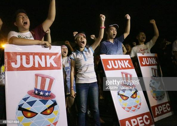 Philippine students shout slogans during a protest against the AsiaPacific Economic Cooperation Summit taking place in Manila on November 17 2015...