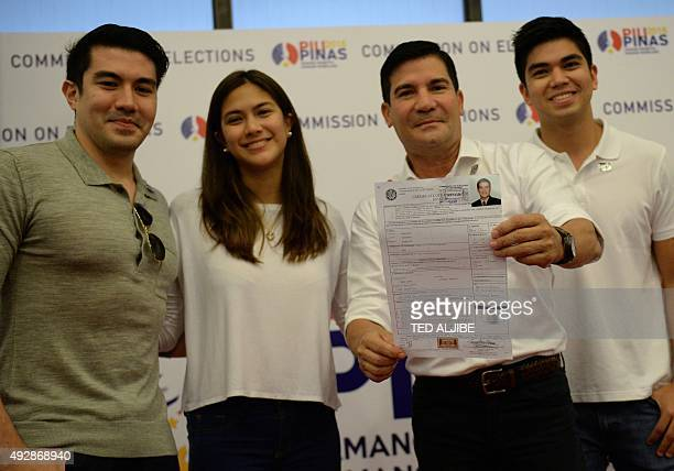 Philippine TV personality and film actor Edu Manzano poses with his children Luis Amanda and Lorenzo as he shows his certificate of candidacy for...
