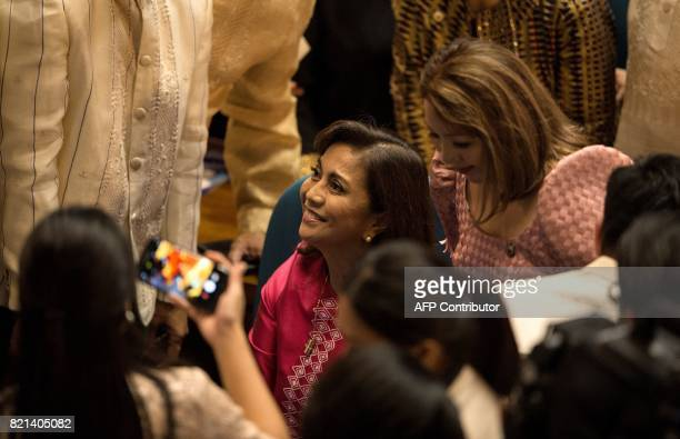 Philippine Vice President Leni Robredo looks up as she arrives at the House of Representatives in Manila on July 24 to attend Philippine President...