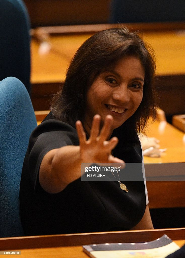 Philippine vice president-elect Leni Robredo greets colleagues prior to her proclamation as the winner of the May 9 vice presidential elections during a joint session at the lower house in Manila on May 30, 2016. The Philippine parliament on May 30 proclaimed Rodrigo Duterte the nation's next president following his landslide election win this month, but he snubbed the high-profile event. Leni Robredo, who was declared the winner of the vice president election and a member of outgoing president Benigno Aquino's Liberal Party, attended the event along with her family and supporters. ALJIBE