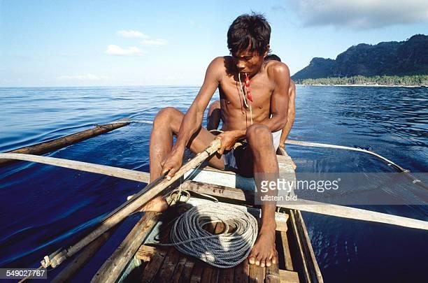 A Badjao fisherman getting his harpoon ready near the island Bongao