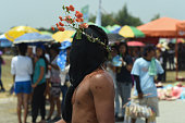 PROVINCE Philippines A penitent wears a flower crown with thorns as he whips himself on the back during lenten rites in San Fernando City province of...