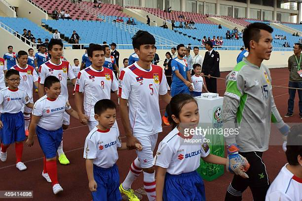 Philippines and Laos enetrs the field prior to kick off during the 2014 AFF Suzuki Cup Group A match between the Philippines and Laos at the My Dinh...