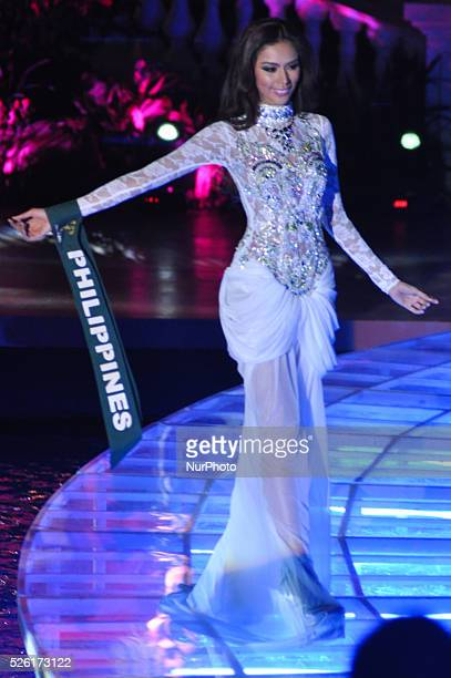 MANILA Philippines Angelee delos Reyes of the Philippines dons her evening gown during the Miss Earth 2013 pageant's grand coronation night held in...
