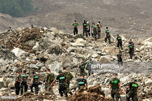 Philippines Army soldiers in rescue operation at a landslide site on February 20 2006 in Saint Bernard Leyte Philippines