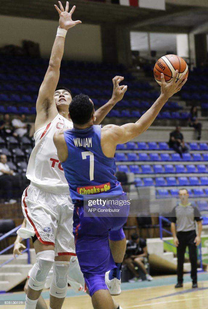 Philippines basketball player Jayson Castro William tries to score during a FIBA AsiaCup 2017 group match against China, in the Lebanese town of Zouk Mikael north of Beirut on August 9, 2017. Phillippines won over China 96 to 87. /