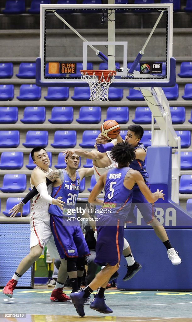 Philippines basketball player Roger Pogoy fights for the ball during a FIBA AsiaCup 2017 group match against China, in the Lebanese town of Zouk Mikael north of Beirut on August 9, 2017. Phillippines won over China 96 to 87. /