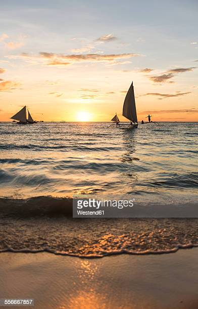 Philippines, Boracay, sunset with sailing boats