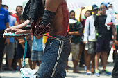 PROVINCE Philippines Bystanders watch as a penitent whips himself on the back during lenten rites in San Fernando City province of Pampanga on Good...