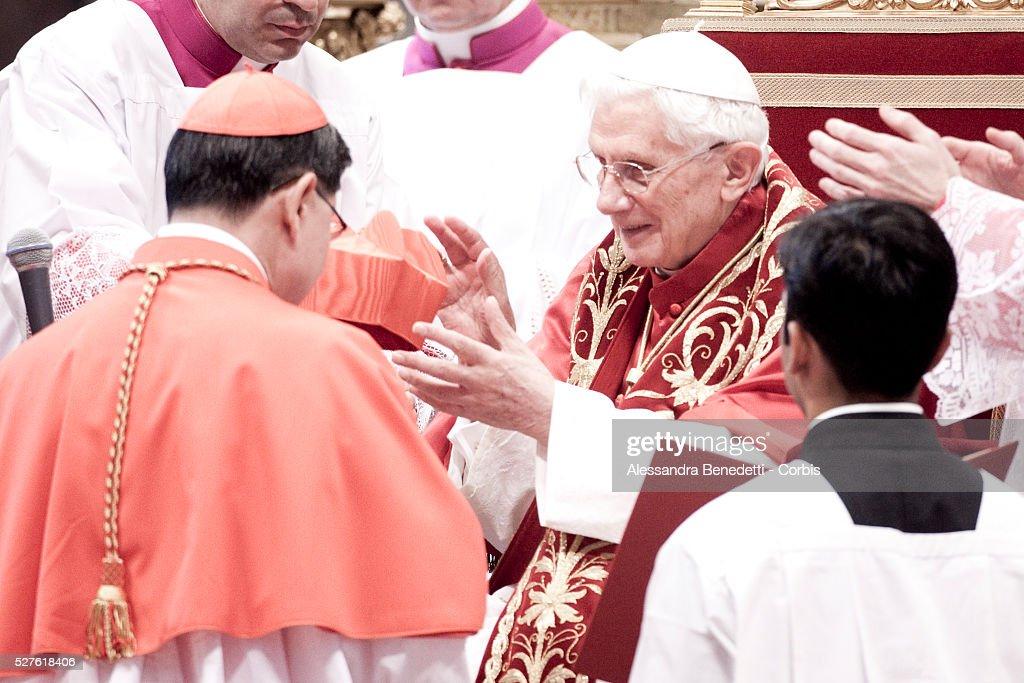 Philippines' cardinal Luis Antonio Tagle eceives the biretta cap from Pope Benedict XVI in Saint Peter's Basilica on November 24 2012 in Vatican City...