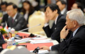 Philippine's Foerign Secretary Albert del Rosario and Japanese Deputy Froeign Minister Tsuyoshi Yamaguchi listen to China's Foreign Minister Yang...