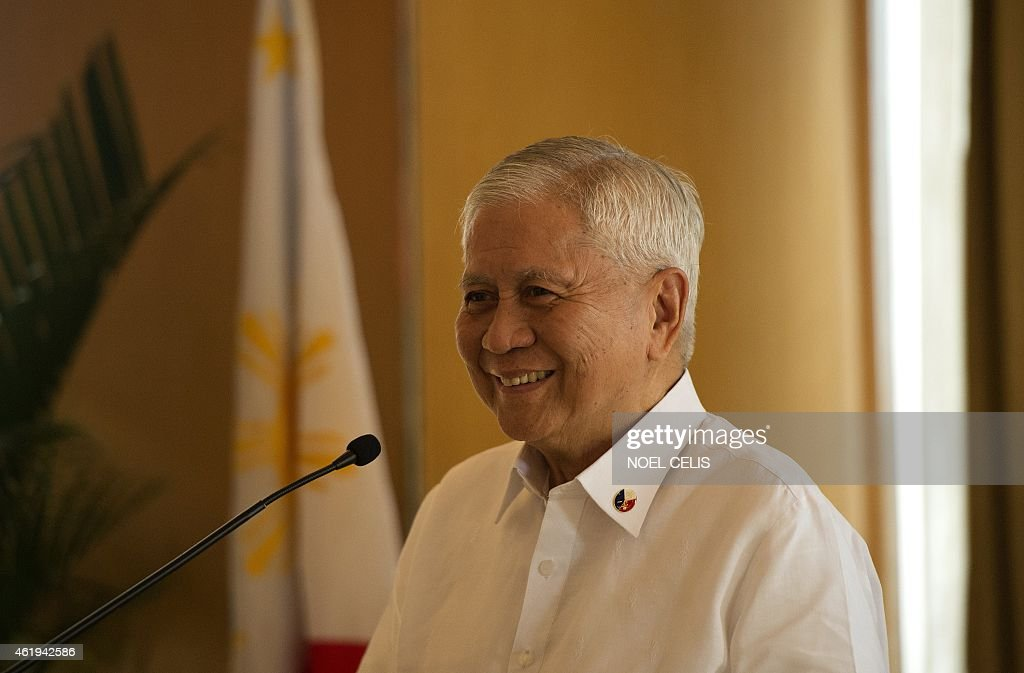 Philippines Foreign Minister <a gi-track='captionPersonalityLinkClicked' href=/galleries/search?phrase=Albert+del+Rosario&family=editorial&specificpeople=2704318 ng-click='$event.stopPropagation()'>Albert del Rosario</a> smiles as he answers questions during a press conference in Manila on January 22, 2015. China's reclamation of land in disputed South China Sea waters is a 'threat' to all nations in Southeast Asia, the Philippines' foreign minister said on January 22. AFP PHOTO / NOEL CELIS