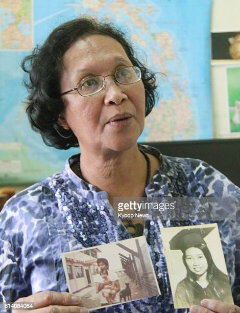 MANILA Philippines Human rights advocacy group Karapatan's leader Marie Enriquez in a photo taken in metro Manila on Sept 6 holds photos of her...