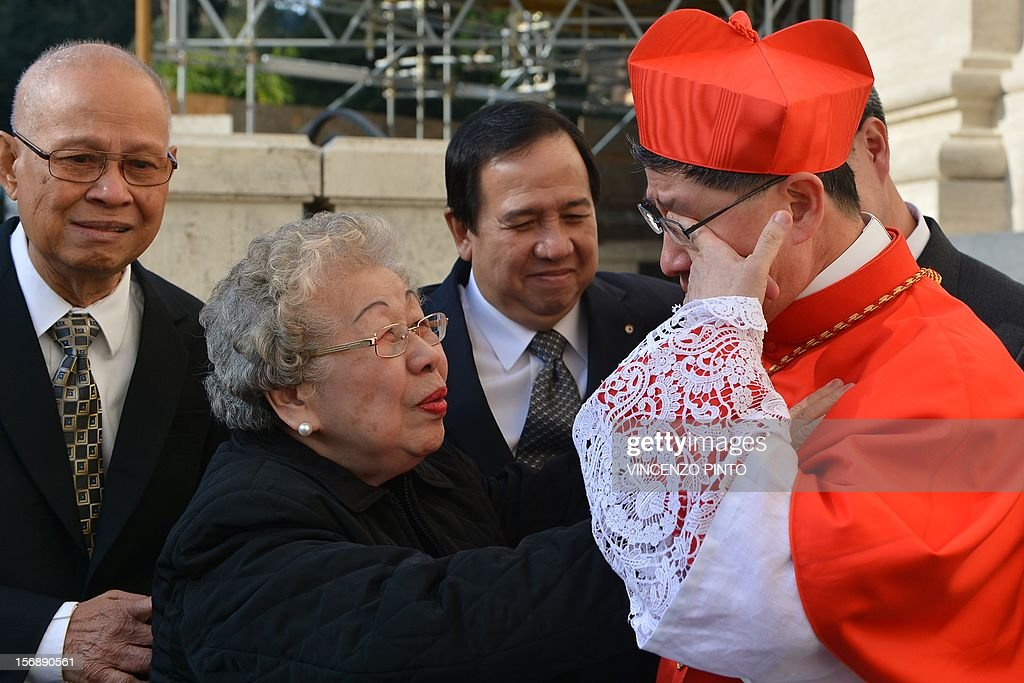 Philippines' Luis Antonio Tagle is congratulated by his family as he cries after the ceremony where he was appointed by the pontif as cardinal on...