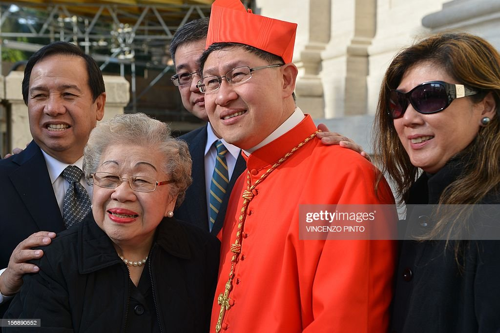 Philippines' Luis Antonio Tagle poses with his family after the ceremony where he was appointed by the pontif as cardinal on November 24 2012 at St...