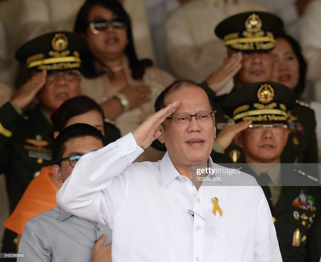 Philippines' outgoing president Benigno Aquino salutes during the testimonial parade for him at the military headquarters in Manila on June 27, 2016. / AFP / TED