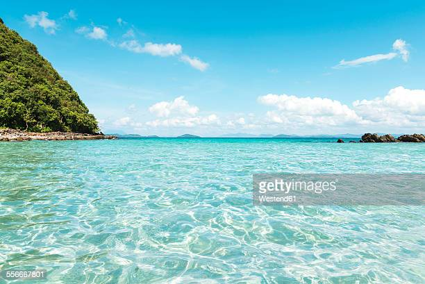 Philippines, Palawan, El Nido, clear turquoise water, blue sky and a small island