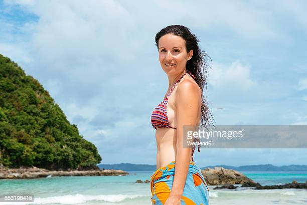 Philippines, Palawan, El Nido, portrait of woman on the beach