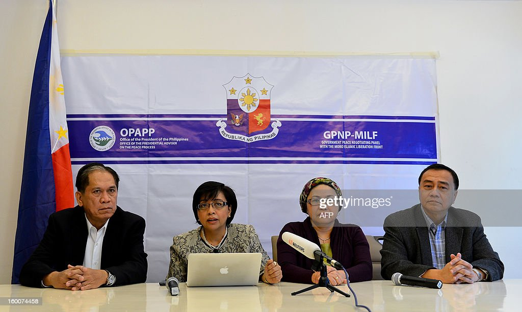 Philippines political science professor Miriam Coronel Ferrer (2nd L), chairperson of the government negotiating panel for peace talks with the Moro Islamic Liberation Front (MILF), speaks during a news conference at the Philippines Embassy in Kuala Lumpur on January 26, 2013 as former Philippine agriculture secretary Senen Bacani (L), Presidential Assistant for Muslim Concerns Yasmin Busran-Lao (2nd R) and Secretary of the Philippine National Commission on Muslim Filipinos Mehol Sadain (R) listen. Philippine President Benigno Aquino and MILF chief Murad Ebrahim witnessed the signing of a framework agreement on October 15, 2012 which aims for a full peace deal by 2016, including significant power and wealth-sharing with the MILF in a new autonomous region in the strife-torn southern Philippines. Muslim rebel groups have been fighting since the 1970s for full independence or autonomy in the south in a conflict that has claimed 150,000 lives.