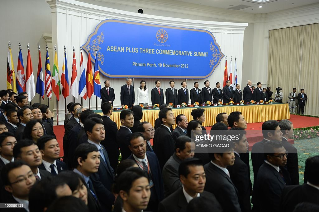 Philippines President Benigno Aquino, Singapore Prime Minister Lee Hsien Loong, Thai Prime Minister Yingluck Shinawatra, Vietnamese Prime Minister Nguyen Tan Dung, South Korean President Lee Myung Bak, Chinese Premier Wen Jiabao, Cambodian Prime Minister Hun Sen, Japan Prime Minister Yoshihiko Noda, Brunei Sultan Hassanal Bolkiah, Indonesian President Susilo Bambang Yudhoyono, Laos Prime Minister Thongsing Thammavong, Malaysian Prime Minister Najib Razak and Myanmar Deputy Foreign Minister Kan Zaw stand together as delegates watch during the Association of Southeast Asian Nations (ASEAN) Plus Three Commemorative Summit in Phnom Penh on November 19, 2012 following the 21st ASEAN Leaders Summit.