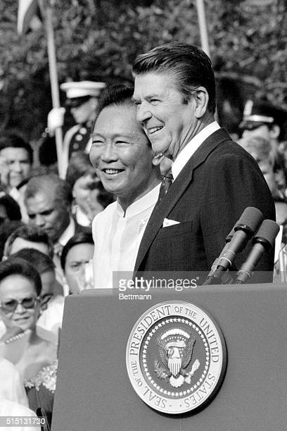 Philippines President Ferdinand Marcos and President Reagan watch the ceremonies on the South Lawn of the White House 9/16 in honor of Marcos' visit