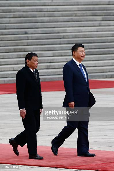 Philippines President Rodrigo Duterte and Chinese President Xi Jinping attend a welcoming ceremony at the Great Hall of the People in Beijing on...