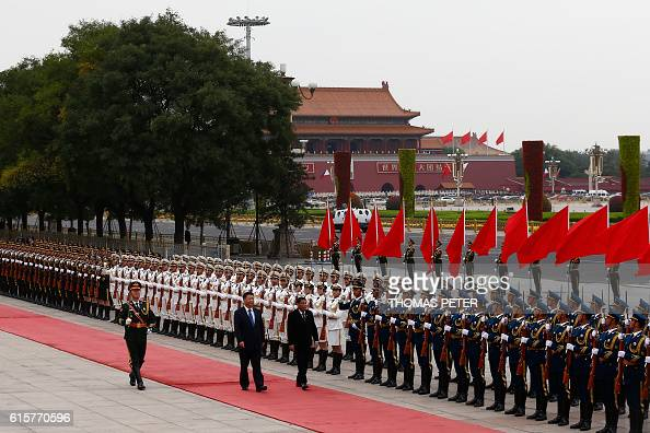 Philippines President Rodrigo Duterte and Chinese President Xi Jinping attend a welcoming ceremony at the Great Hall of the People in Beijing China...