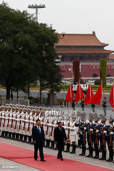 Philippines President Rodrigo Duterte and Chinese President Xi Jinping review the guard of honors as they attend a welcoming ceremony at the Great...